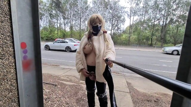 Exhibitionist whore flashing in a fur coat by a busy road public boobs